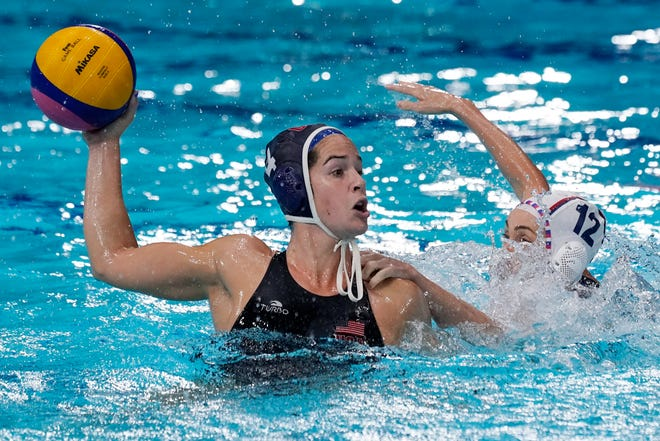 Rachel Fattal (4) is defended by Nadezhda Glyzina (12) of the Russian Olympic Committee during the semifinals. The U.S. women's water polo team is seeking its third consecutive gold medal.