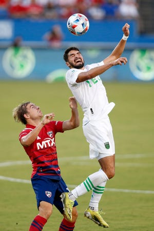 Manny Perez heads the ball against FC Dallas midfielder Paxton Pomykal during the first half at Toyota Stadium. Austin FC failed to score for the 10th time in the last 13 matches.