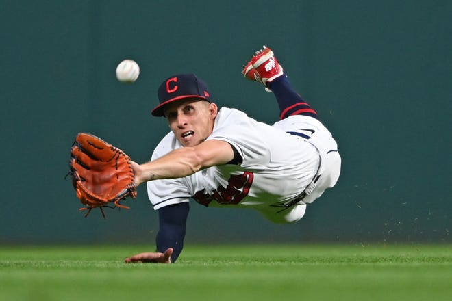 Cleveland outfielder Myles Straw dives for a ball hit by the Detroit Tigers' Victor Reyes in the fifth inning of Saturday night's game at Progressive Field. [David Dermer/Associated Press]