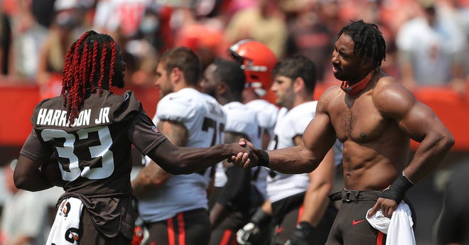 Browns defensive end Myles Garrett (95) shakes hands with defensive back Ronnie Harrison (33) during the Orange and Brown practice at FirstEnergy Stadium on Aug. 8 [Jeff Lange/Beacon Journal]