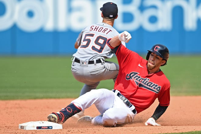 Cleveland outfielder Bradley Zimmer slides into second base after hitting a double in the fifth inning of a 7-5 win over the Detroit Tigers on Sunday. Zimmer is trying to finally show enough consistency to earn a permanent spot in the big leagues. [David Dermer/Associated Press]