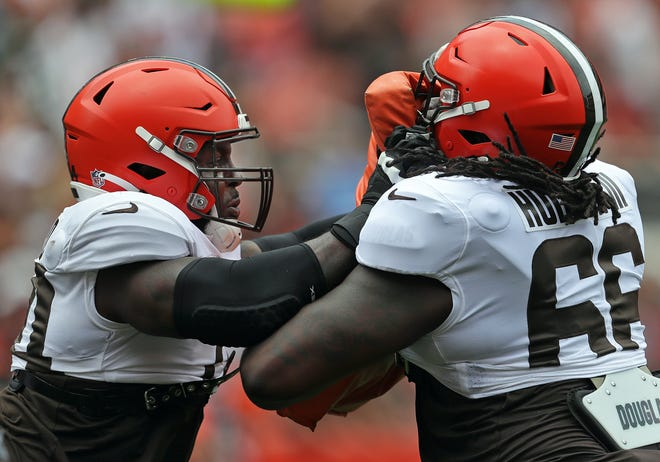 Browns offensive tackle Chris Hubbard, left, used adversities he faced last season as teaching moments as a father. [Jeff Lange/Beacon Journal]