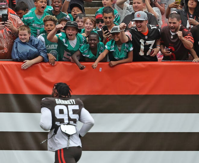 Browns defensive end Myles Garrett (95) wants to bring the fans their first Super Bowl title. [Jeff Lange/Beacon Journal]