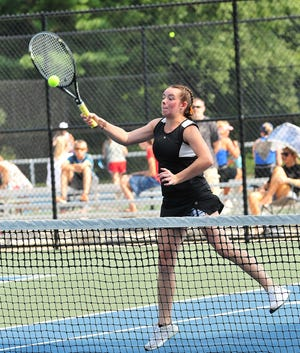 Ashland High School's Haley Lefever returns the ball to Orrville in first doubles action during the Ashland Invitational Saturday at Brookside Park.