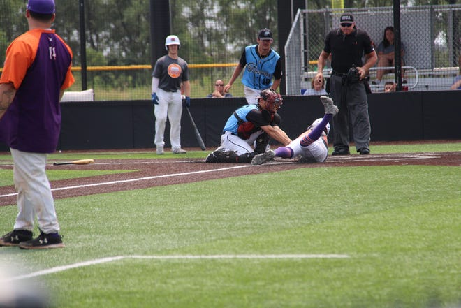 Jared Hanks tags Kansas Curve runner out at home in 6-2 semi-final win.