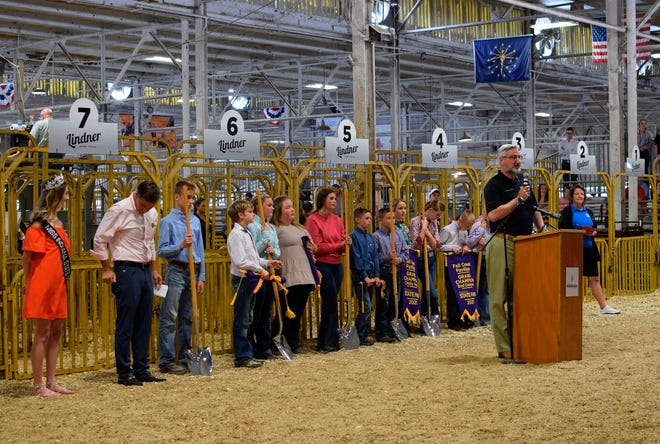 Indiana Gov. Eric Holcomb speaks at the groundbreaking for the Indiana State Fairgrounds' new Fall Creek Pavilion, which will replace the century-old Swine Barn on Friday in Indianapolis.  The project is part of a historic building spree soon to begin in Indiana.