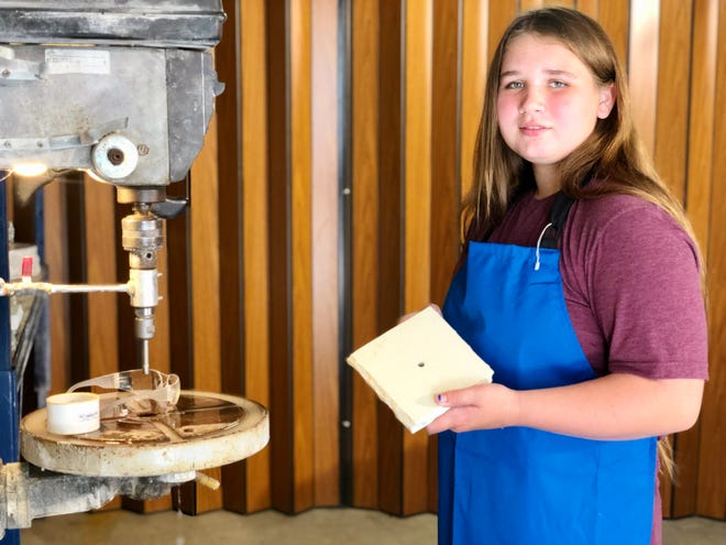 Nicole Westhusing in her workshop making candles.