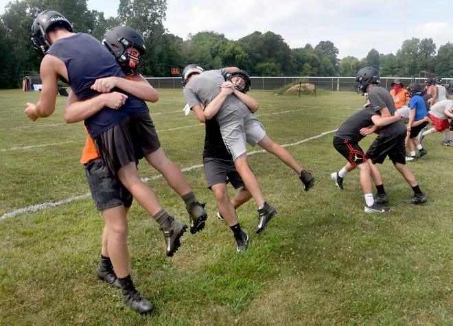Summerfield runs a tackling drill on the first day of football practice last year. The Bulldogs will be the first team to hit the field again this year.