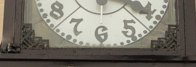 This is a close-up of the First Merchants Bank Chime Clock's fascia prior to restoration; the scroll design used by the McClintock-Loomis Co. in the 1910s is clearly visible.