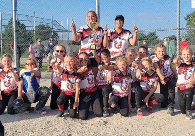 The Bedford Lady Mules 10-U Fast-pitch softball team celebrates its championship of the Smashin' Balls Tournament at Stoneco. The team is made up of (front row, left to right) Elyse Wagenhauser, Lexi Diesing, Mackenzie Kester, Avery Welch, Mara Berry, Luna Gallup, Josie Adams, Kylie Jaworski, Alexis Williams, Abby Pakulski, Presley Stark and Charlotte Bates and (back row: Ashlee Stark and Denise.
