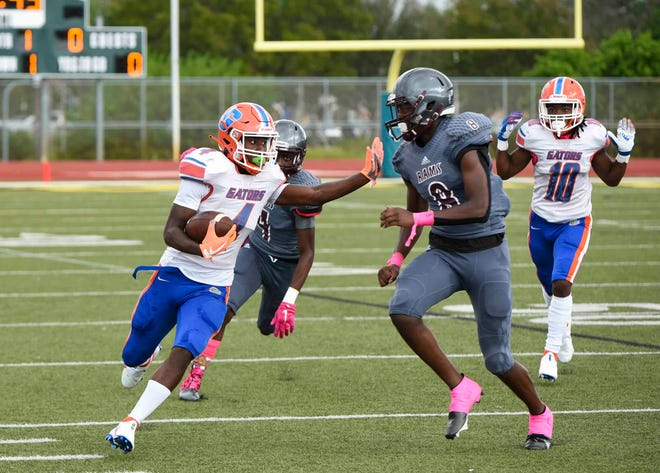 Palm Beach Lakes linebacker Trevon Cooper tries to tackle Palm Beach Gardens receiver Jamarri Brown during a game last October.