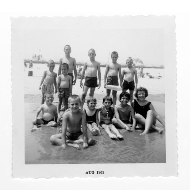 John Walsh, far left, second row, with cousins at Scarborough Beach in 1963.