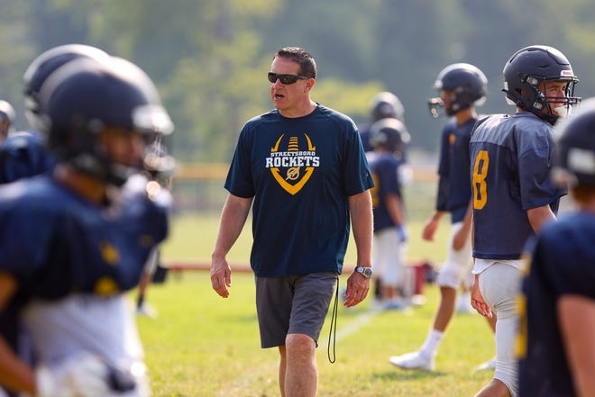 Streetsboro head coach Pete Thompson gets his players ready for a scrimmage against Kent Roosevelt on Saturday morning in Kent.