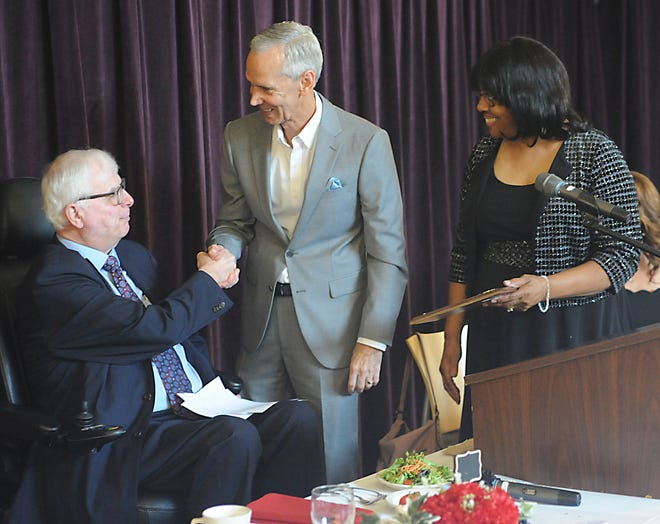 Randall Flint, center, shakes hands with Alliance Mayor Alan Andreani after Flint was named Citizen of the Year during the 2021 Greater Alliance Carnation Festival Chamber of Commerce Luncheon Saturday, Aug. 7, 2021. Also pictured is festival board member Missy Miller.