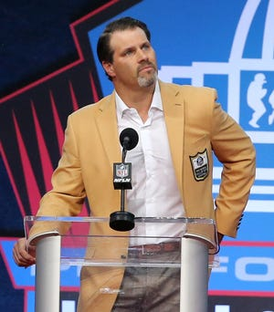 Steve Hutchinson gets choked up talking about his family during his enshrinement speech for the Pro Football Hall of Fame at Tom Benson Hall of Fame Stadium on Saturday, Aug. 7, 2021.