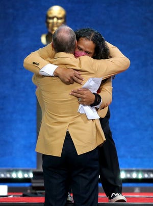 Troy Polmalu is hugged by his former Pittsburgh Steeklers coach Bill Cowher at the end of his enshrinement speech. Troy Polmalu was enshrined in the Pro Football Hall of Fame at Tom Benson Hall of Fame Stadium on Saturday, August 7, 2021.Polmalu was presented by Steelers defensive coordinator Dick LeBeau.
