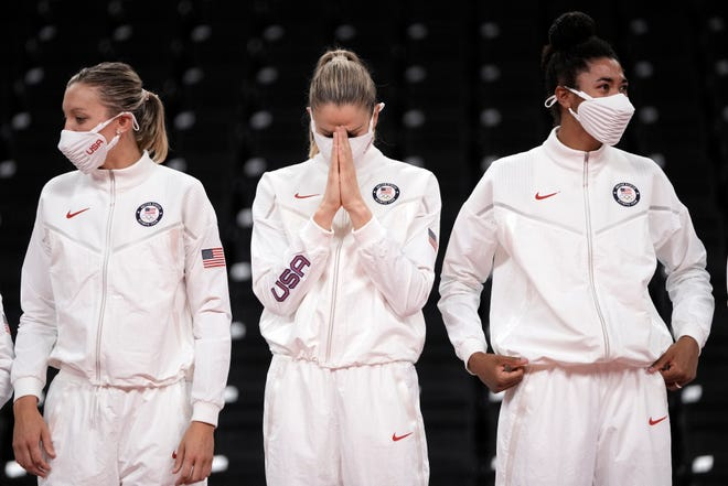 Former Purdue All-American Annie Drews, center, reacts alongside teammates Michelle Bartsch-Hackley, left, and Haleigh Washington, right, after winning the gold medal in women's volleyball at the 2020 Summer Olympics Aug. 8, 2021, in Tokyo, Japan.