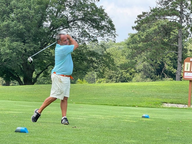 Aris Andrews hits his tee shot on No. 2 at Erskine Park Golf Club During a sudden death playoff Sunday. Andrews parred the hole to defeat Randy Moreno for the South Bend Senior Metro championship.