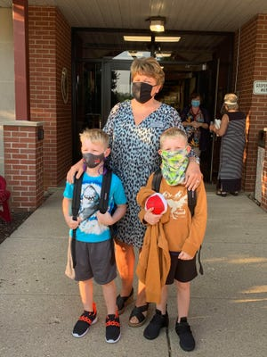 Gosport Elementary Principal Carol Watson greeted students as they arrived for the first day of school.  Pictured above with Mrs. Watson are second-grade twin brothers Preston and Aidan Trader.  Preston and Aiden are the grandsons of the late Irene Brock, who was previously the principal at GES.