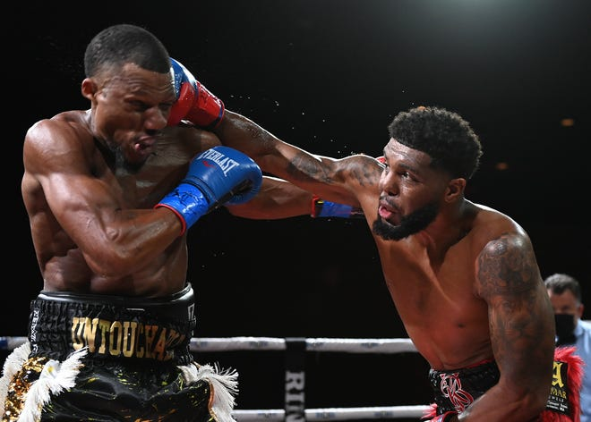 Worcester's Kendrick Ball Jr., right, lands a right hand Saturday against Tyi Edmonds at MGM Springfield. Ball won by unanimous decision in the first defense of his WBC USNBC Silver Super Middleweight Title.