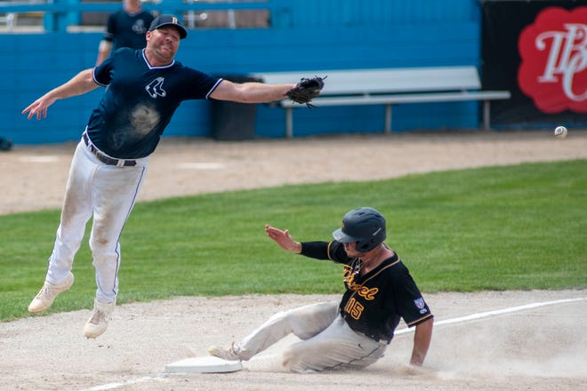 Berea Blue Sox third baseman Steve Ross (25) misses the ball and Buffalo Diesel's Jacob Victor (15) runs to home on Sunday, Aug. 8, 2021 at C.O. Brown Stadium in Battle Creek, Michigan.