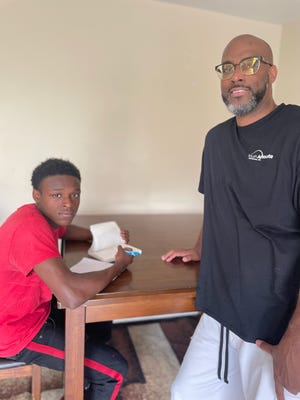 Damarion and Onyango Collier. Collier is an advocate with a new program in Hamilton County helping high-risk, high-need youth.