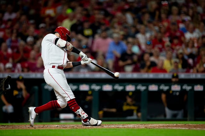 Cincinnati Reds right fielder Jesse Winker (33) hits an RBI single in the sixth inning of the MLB baseball game between the Cincinnati Reds and the Pittsburgh Pirates on Saturday, Aug. 7, 2021, at Great American Ball Park in Cincinnati.