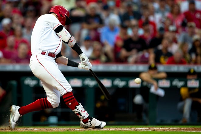 Cincinnati Reds right fielder Jesse Winker (33) hits a double in the third inning of the MLB baseball game between the Cincinnati Reds and the Pittsburgh Pirates on Saturday, Aug. 7, 2021, at Great American Ball Park in Cincinnati.