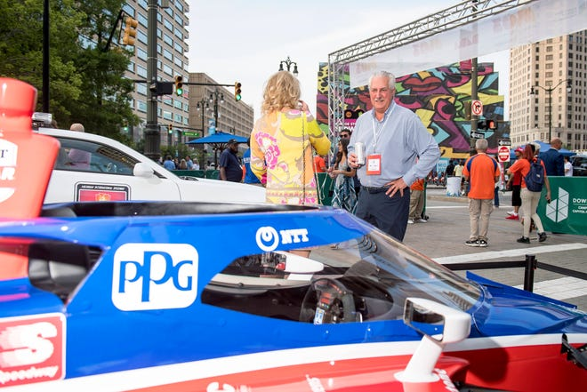 Keith Studzinski of Bloomfield Hills looks at the vehicles on display during the Motor City Car Crawl Charity Gala at Campus Martius Park.
