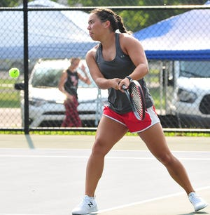 Shelby's Sadie Smith returns the ball to Ashland in third singles play during the Ashland Invitational on Saturday at Brookside Park.