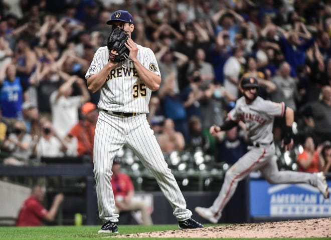 Brewers reliever Brent Suter reacts as Kris Bryant of Giants races home with the tying run in the ninth inning Saturday night thanks to a three-base error by rightfielder Avisail Garcia.