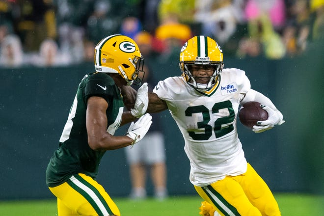Green Bay Packers running back Kylin Hill (32) runs the ball against cornerback Kabion Ento (48) during Packers Family Night at Lambeau Field, Saturday, Aug. 7, 2021, in Green Bay, Wis. Samantha Madar/USA TODAY NETWORK-Wisconsin