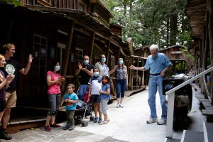 Roger Tofte waves to guests applauding him as he arrives for a Q&A session for the park's 50th anniversary celebration in Enchanted Forest outside Salem, Oregon, on Sunday, August 8, 2021.