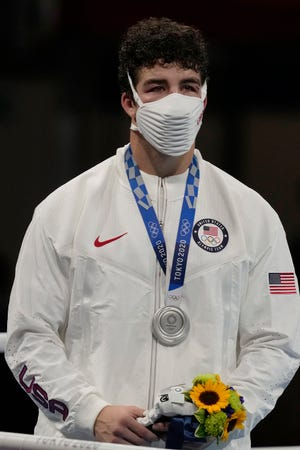 Silver medal winner Richard Torrez Jr., from the United States during the men's super heavyweight over 91-kg boxing medal ceremony at the 2020 Summer Olympics, Sunday, Aug. 8, 2021, in Tokyo, Japan. (AP Photo/Themba Hadebe)