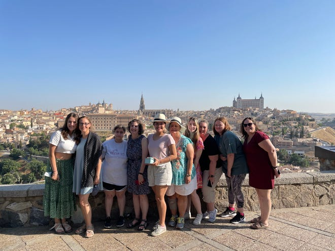 Girl Scout troop 1124 topped 12 years of Girl Scouting with a trip to Spain in July. In Toledo, they took this picture over a scenic overlook. When not with the group and not outdoors, they followed guidelines and wore masks.