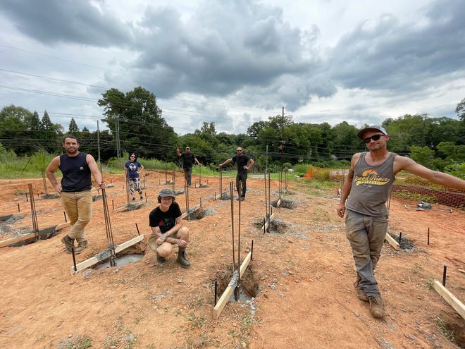 Construction crew members (L-R) Max Harden, Tatiana Veneruso, Eli Saragoussi, Andrew Kovacs, Kyle May and Patrick Sprague at the site of the future Rainbow Forest public art exhibit at the North Oconee River Greenway in Athens on Friday, Aug. 6, 2021.