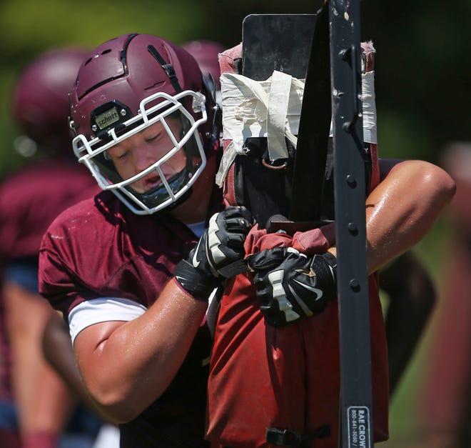 Woodridge lineman Alistair Larson participates in drills during a football practice behind the school, Thursday, Aug. 5, 2021, in Cuyahoga Falls, Ohio.