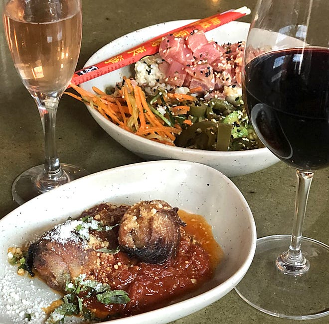 Roasted dates and an ahi tuna bowl appetizer are seved at One Red Door on Saturday in Hudson. A glass of Dibon Brut Rose Cava and Newsprint cabernet franc are great wines to pair with both dishes.