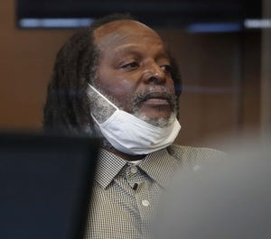 Stanley Ford sits in the courtroom during a hearing before Summit County Court of Common Pleas Judge Christine Croce July 30 in Akron.