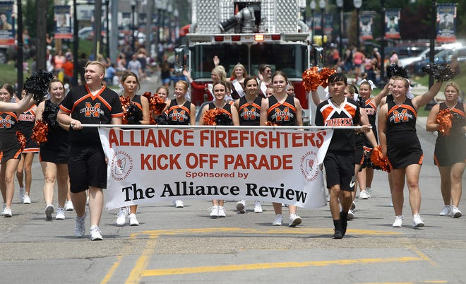 Marlington's cheerleaders led the way behind a color guard to start the Carnation Festival's Kick Off Parade as it heads south Sunday, Aug. 8, 2021, on Union Avenue.