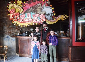 Peter and Caila Excho stand with their children Theija, left, Billiey, center, and Aden, right, at Pexcho's American Dime Museum. Peter opened the museum in 2019.