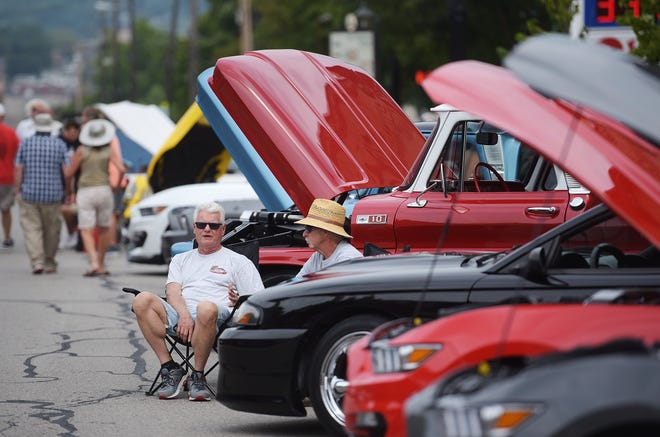 Ed Horvath of Center Township and Michael Hyre of Baden talk beside Hyre's 1965 Chevy C10 during the Hot Summer Nights Car Cruise Saturday in Beaver.