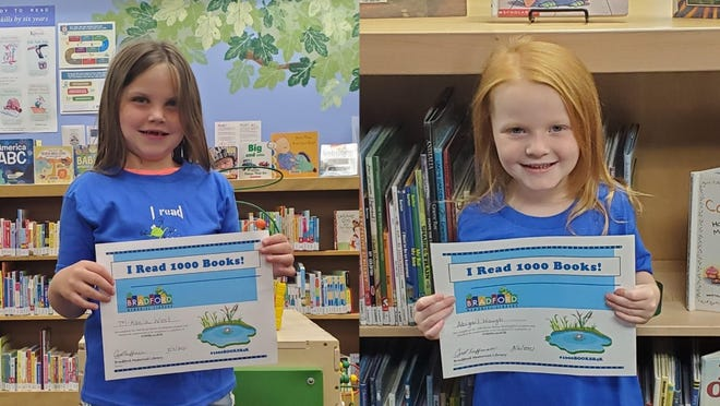 Mikaela West (left) and Abigail Waugh (right) complete the 1,000 Book Challenge