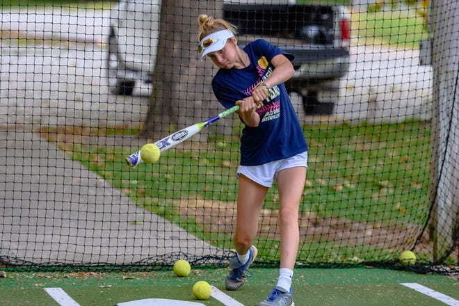 Lauren Christ practices in the batting cage last Wednesday at the Daniel Boone Little League fields in Columbia.