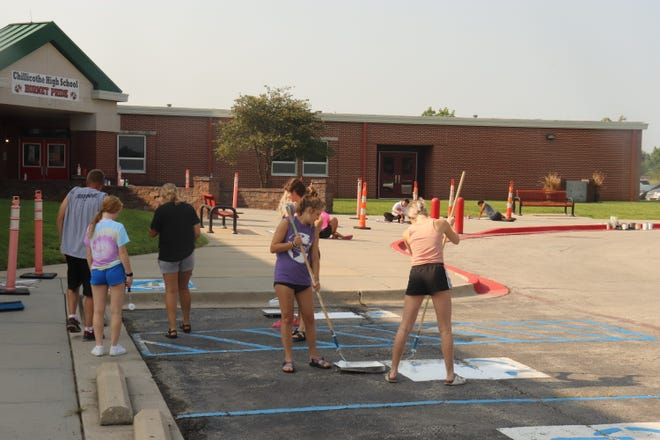 Chillicothe High School student council members spent Monday morning repainting school logos, mascots and handicapped parking space symbols outside the school entrance to help get the school ready for the first day of school on Aug 24.