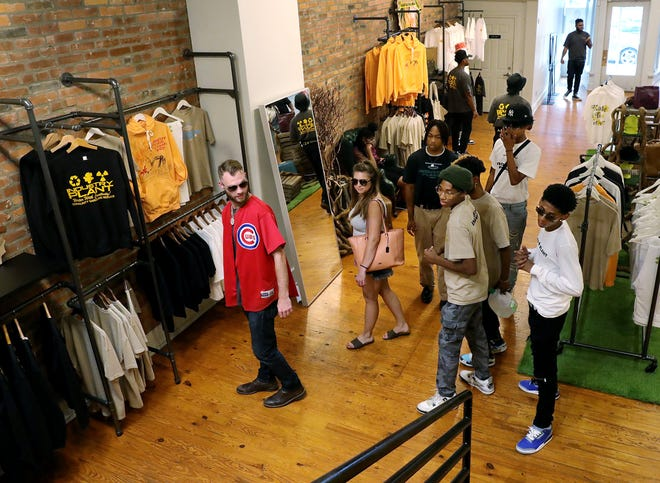 The Columbus Fashion Alliance and My Brother's Keeper Village hosted a fashion internship for Black teens this summer. Customer Ryan Newman, far left, and his girlfriend, Erica Tompkins, second from left, get plenty of assistance as they browse a pop-up shop in the Short North hosted by the youths.