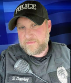 Scott Dawley, a Nelsonville police officer who was killed Aug. 3 in a three-vehicle crash while responding to a report of gunfire in the Athens County community.