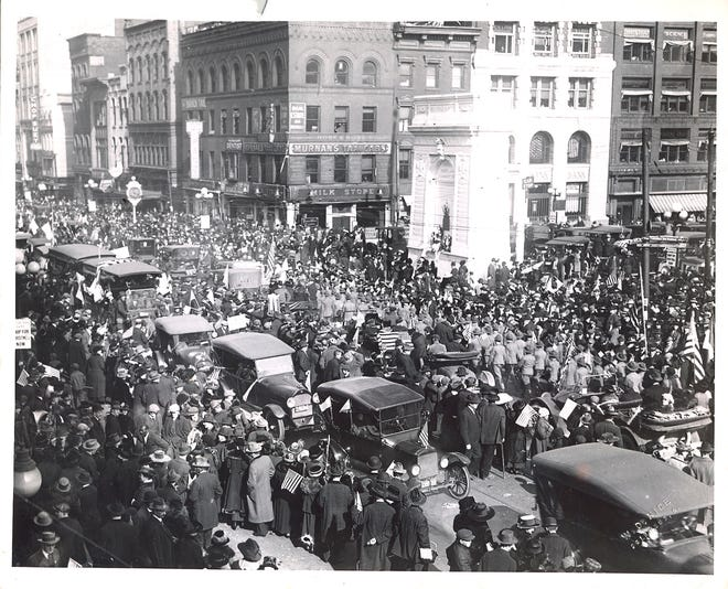This was the scene at Broad and High streets. at precisely 11:20 a.m., Monday, Nov. 11, 1918. Though the influenza pandemic had arrived Columbus, thousands jammed the Downtown area to celebrate the end of World War I. Dispatch photographer Walter D. Nice captured the moment from the Huntington Bank building.