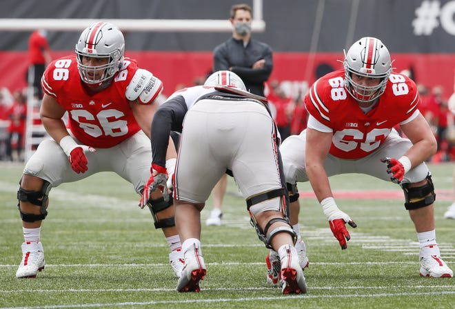 Team Brutus offensive guard Enokk Vimahi (66) and offensive guard Ryan Jacoby (68) block during the Ohio State Buckeyes football spring game at Ohio Stadium in Columbus on Saturday, April 17, 2021.