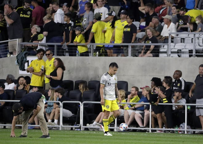 Columbus Crew midfielder Lucas Zelarayan walks disappointedly off the field after losing 3-2 to Atlanta United.